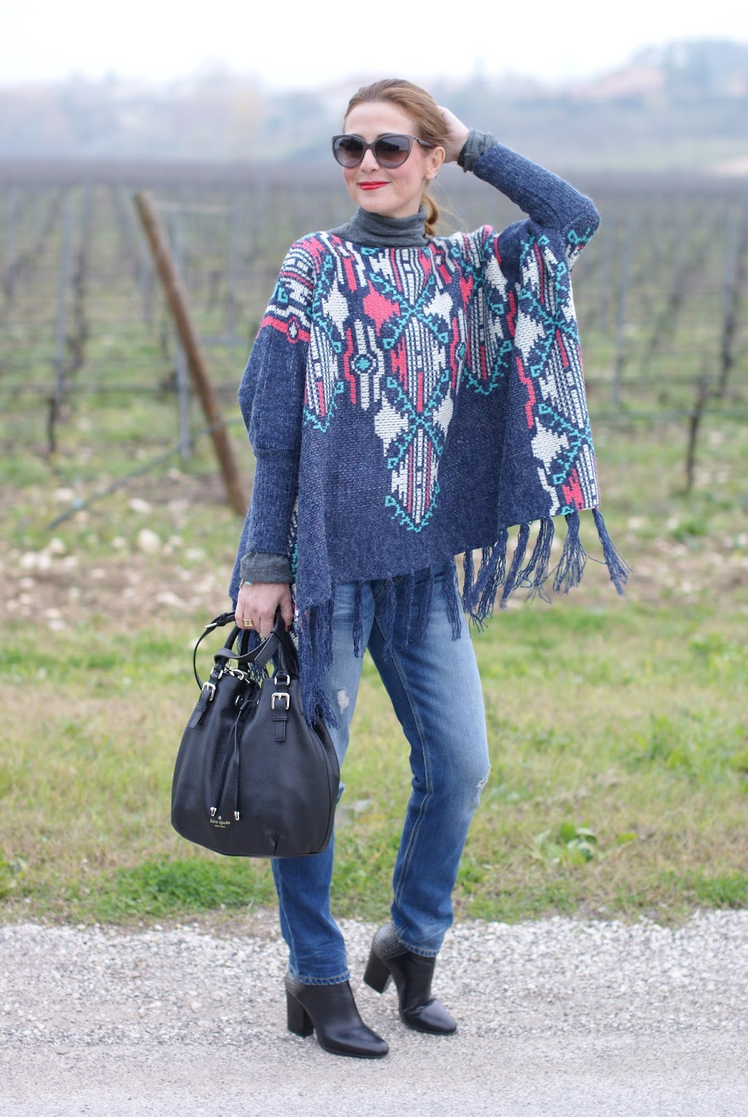 western girl style with Fringed aztec poncho for a western inspired outfit on Fashion and Cookies fashion blog, fashion blogger style