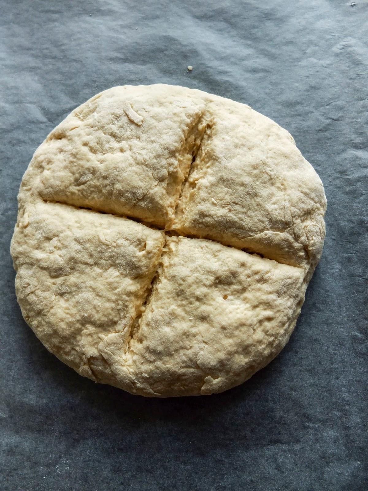 Irish Soda Bread before baking, cross shape cut into the dough.