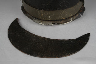 leather shako and brim conservation and stabilization, mounting for exhibit and storage. Preservation of military collectibles, artifacts and antiques