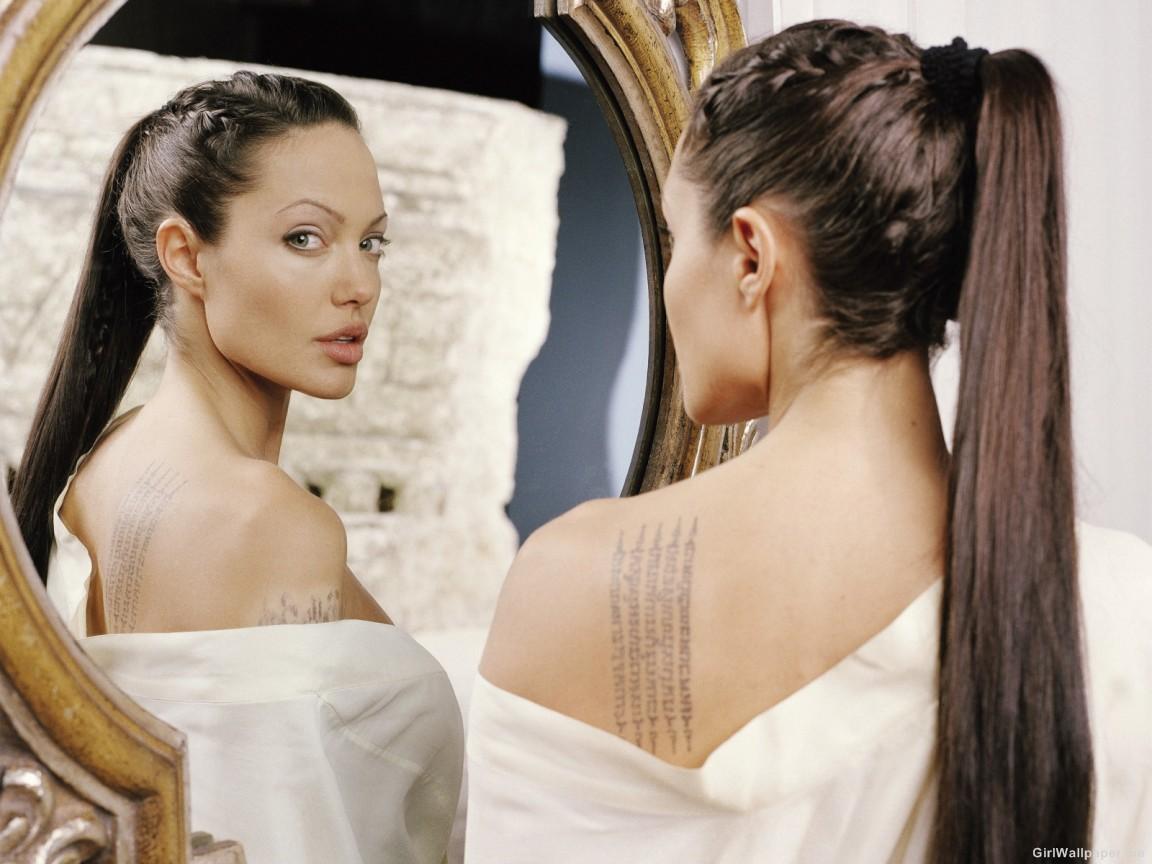 Choosing Tattoo: Angelina Jolie Tattoo On Back