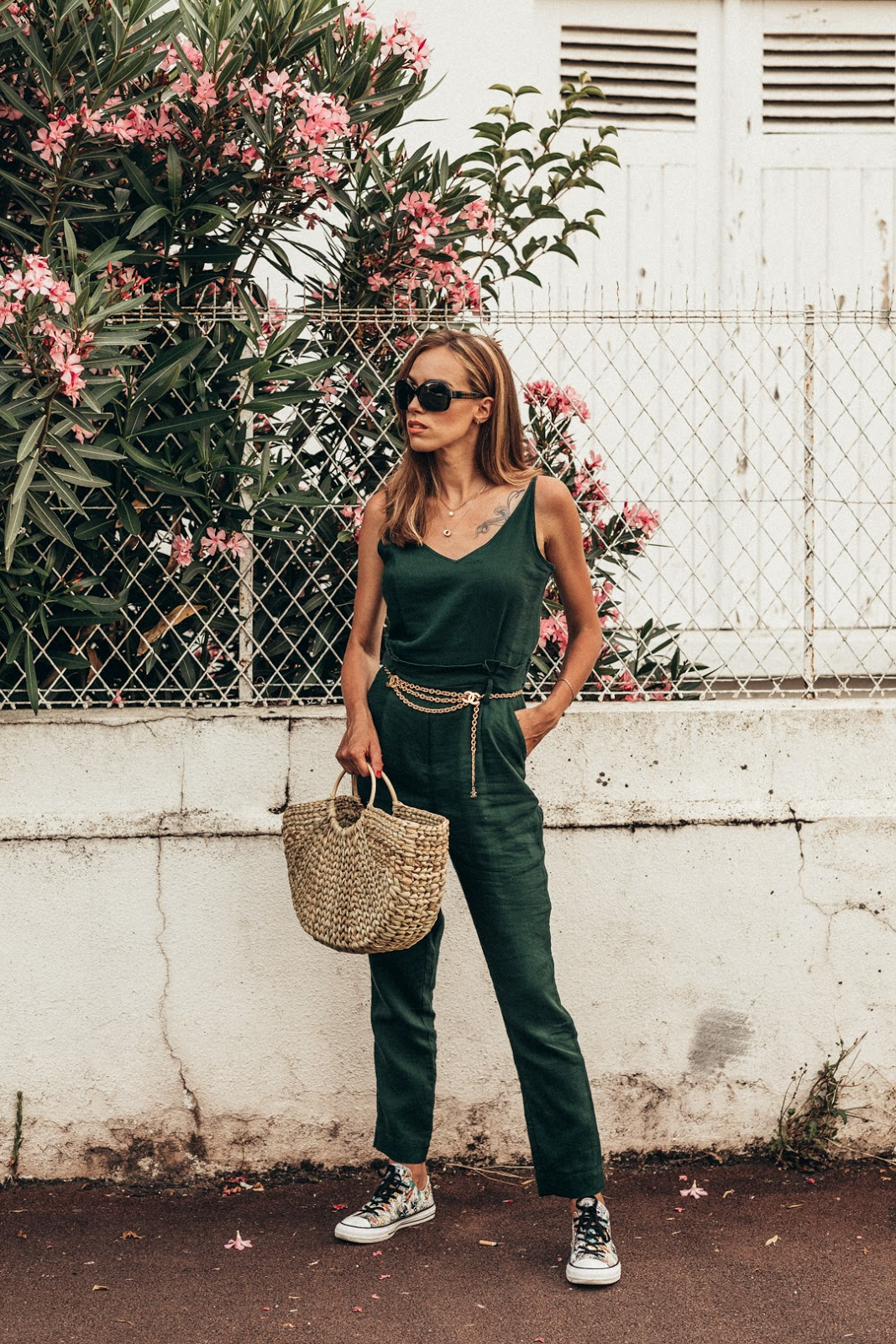 green jumpsuit chanel belt straw bag summer outfit