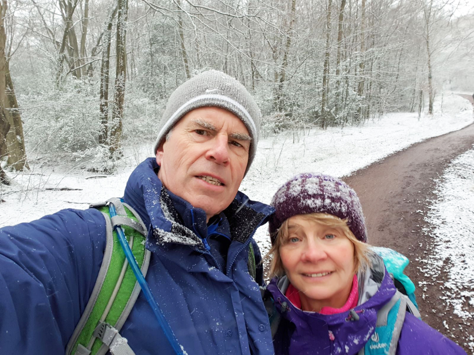 Image showing a man and woman in a frosty forest wearing hiking clothes