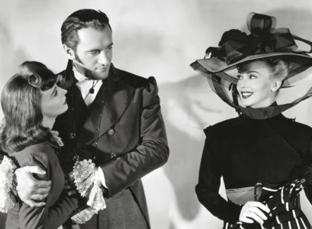 Signe Hasso, George Sanders and Carole Landis in A Scandal in Paris (1946)