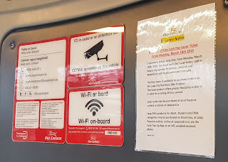 customer information signs on a Galway city bus - fare changes, CCTV in operation, WI-fi on board, rules of carriage, passenger bylaws summary