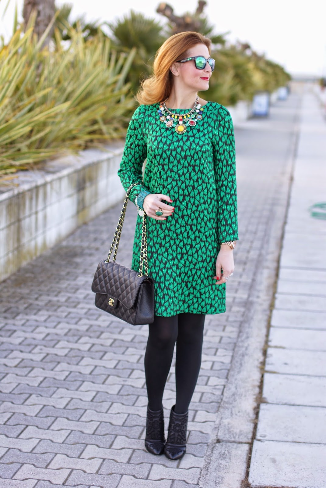 c2d8ee2beed5 Mauro Grifoni dress Oakley sunglasses Chanel bag Dolce & Gabbana ankle boots