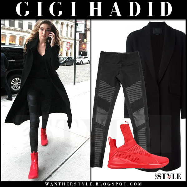 Gigi Hadid in black coat and red sneakers puma rihanna fenty what she wore streetstyle