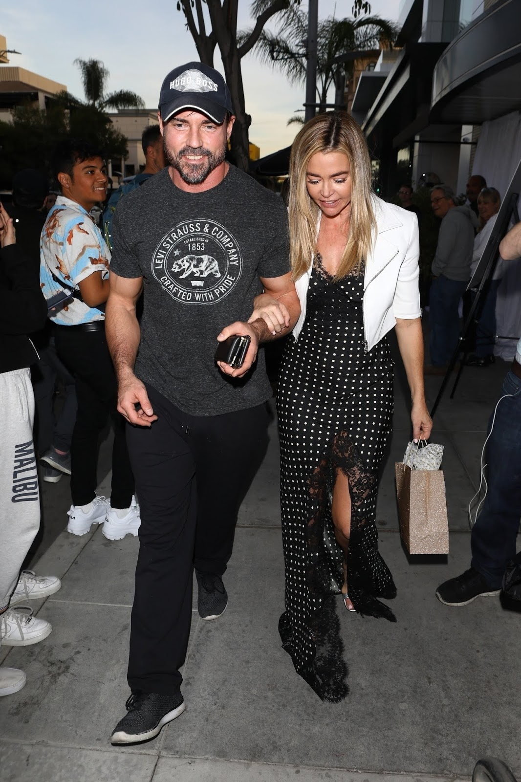 Denise Richards and Aaron Phypers attends Andy Cohen's baby shower at the Palm Restaurant in Beverly Hills - 01/26/2019