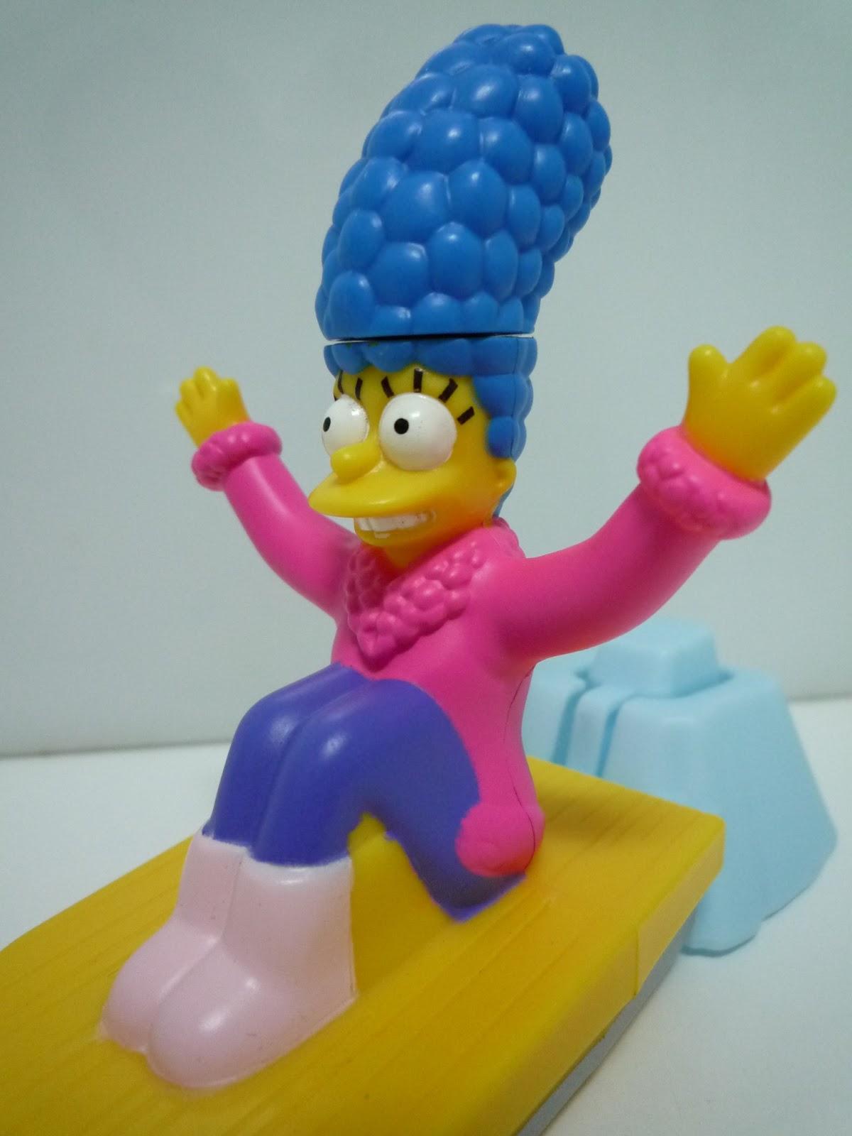 """a449c9897384a El aspecto en el que """"Marge Simpson"""" es sobresaliente es el """"Factor  Diversión"""". Este producto cuenta con un mecanismo (O disparador) que hace  de lanzadera y ..."""