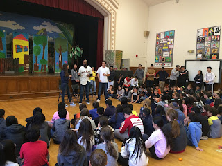 San Francisco Giants player Austin Jackson stands with students at Lafayette Elementary School