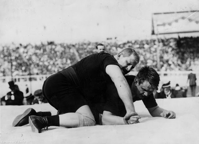 Hungarian Weisz Richárd became the Olympic super heavyweight, Greco-Roman Wrestling champion after beating Russian Alexander Petrov. Your Russians are missing and other stories about past Olympics. marchmatron.com