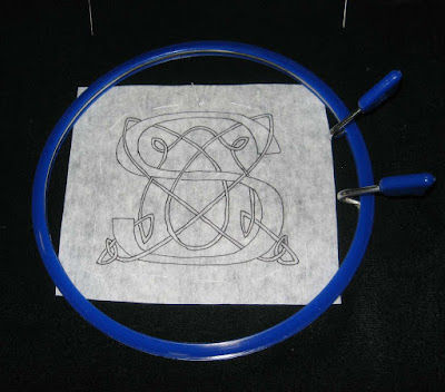 Use embroidery hoop big enough for design