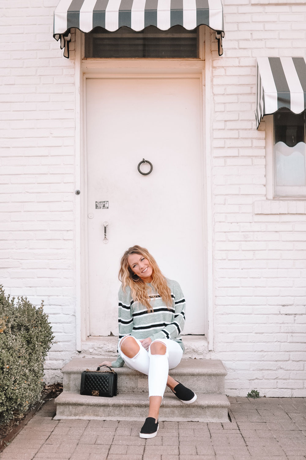 "Amanda Martin, Oklahoma Blogger ""Amanda's OK,"" wears a spring transition outfit, striped sweater and distressed white jeans"