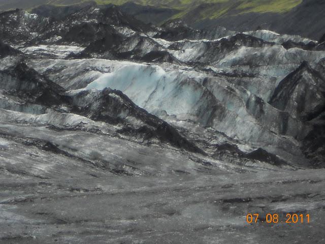 Glacier blackened by volcanic ash