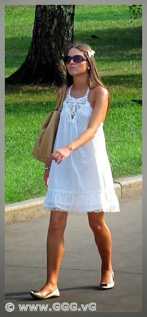 Girl walking in white summer dress