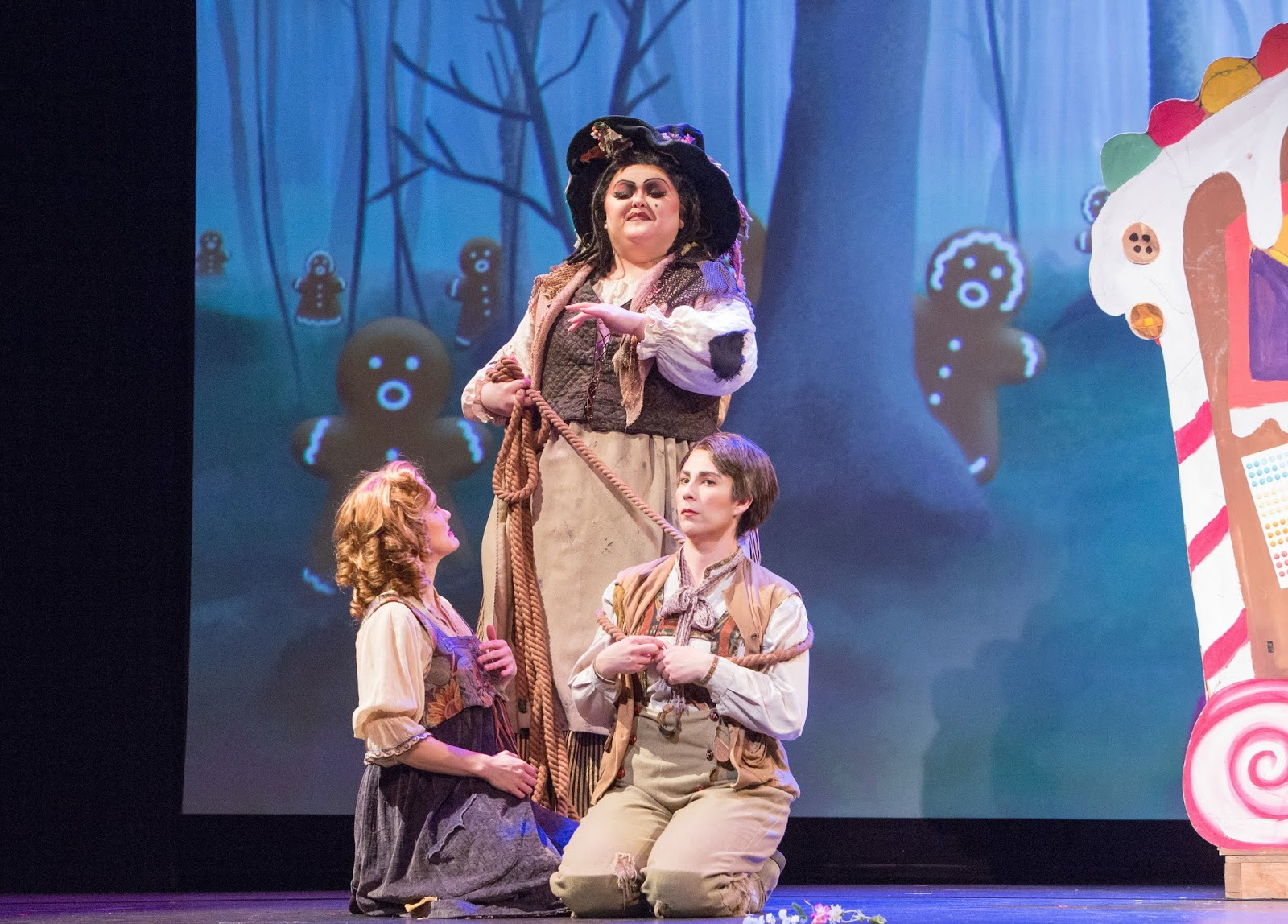 IN PERFORMANCE: (from left to right) soprano JOANN MARTINSON DAVIS as Gretel, mezzo-soprano GRETCHEN KRUPP as Die Knusperhexe, and mezzo-soprano STEPHANIE FOLEY DAVIS as Hänsel in Greensboro Opera's March 2019 production of Engelbert Humperdinck's HÄNSEL UND GRETEL [Photograph © by VanderVeen Photographers]