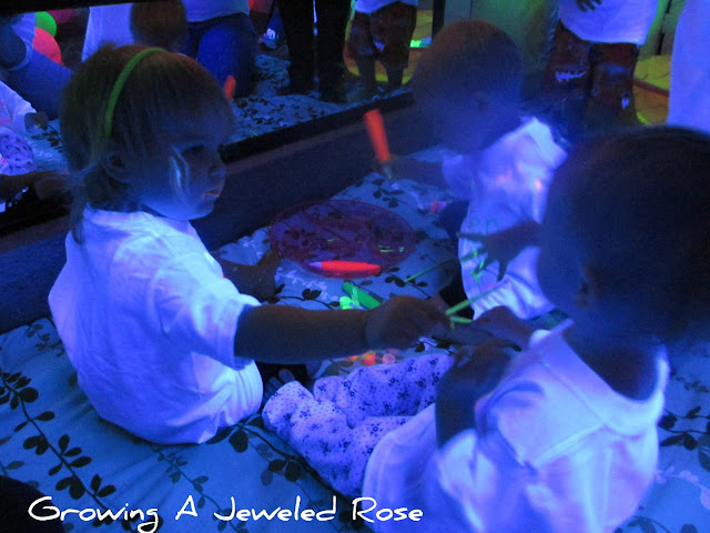 glowing face paint blacklight play