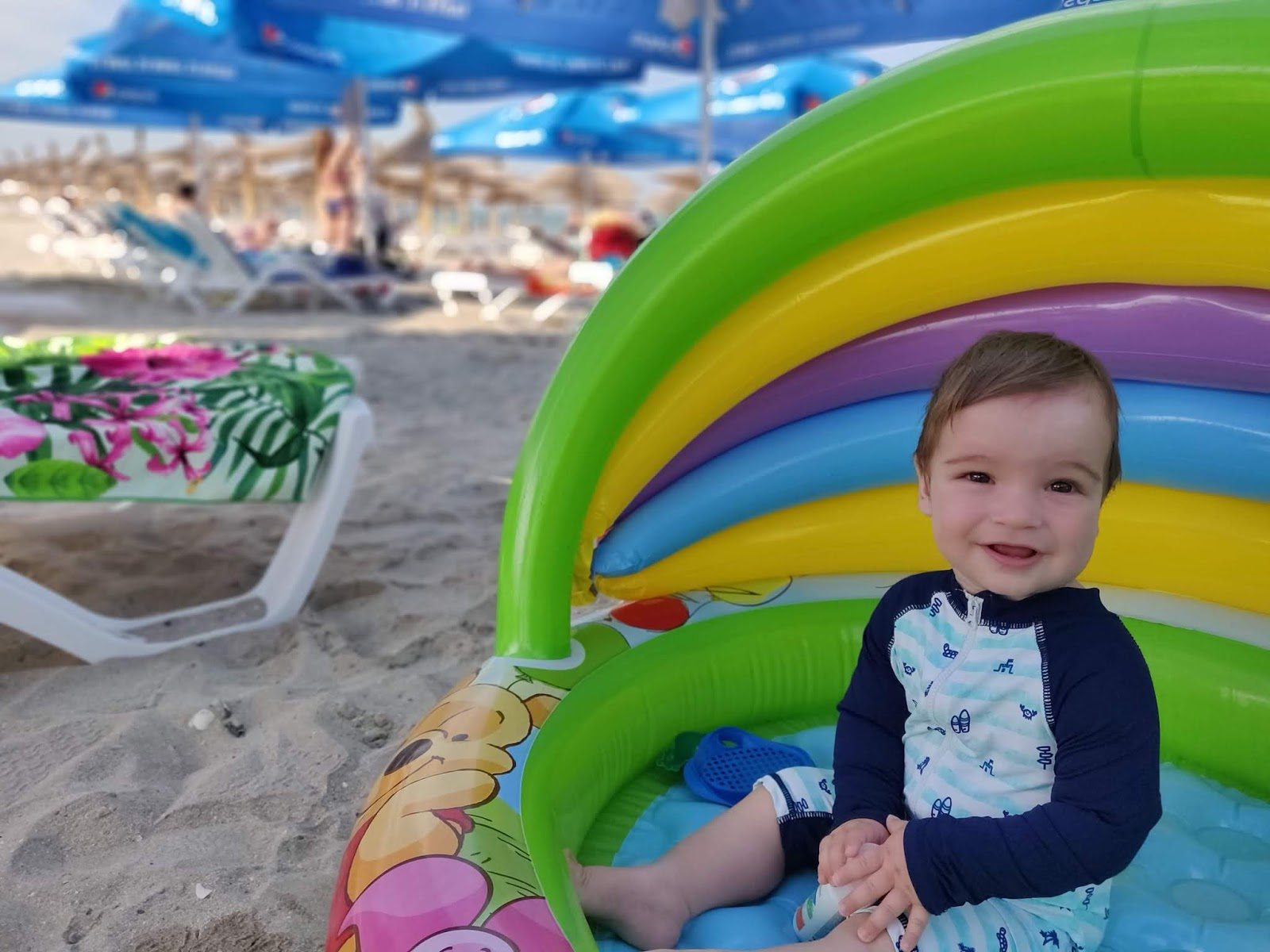 baby in paddling pool at the seaside