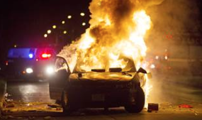 Milwaukee Crowd Turns Violent After Police Fatally Shoot Armed Man