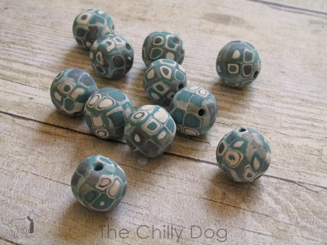 Polymer Clay Tutorial: How to apply cane slices to make colorful clay beads.