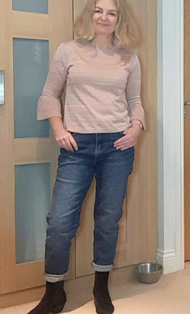 image showing mom jeans outfit with sock boots