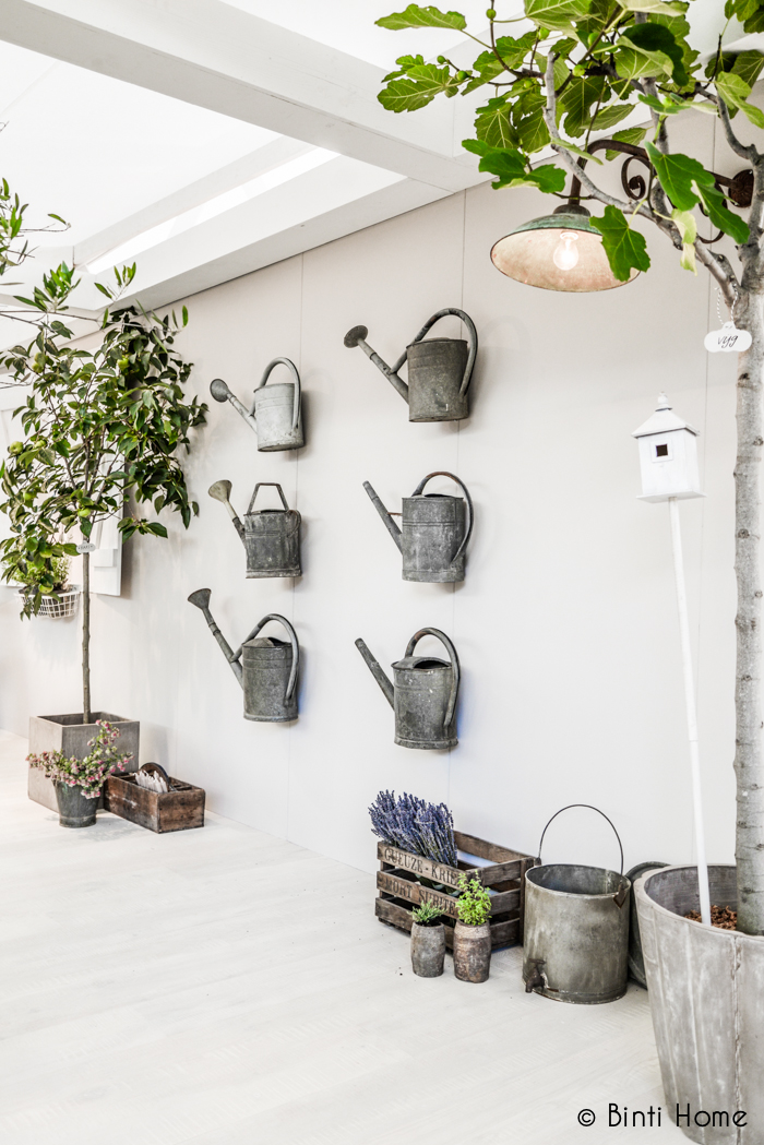 Gallery wall of watering cans from Binti Home