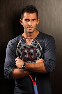 Simona Halep Boyfriend Horia Tecau Posing With His Tennis Racket