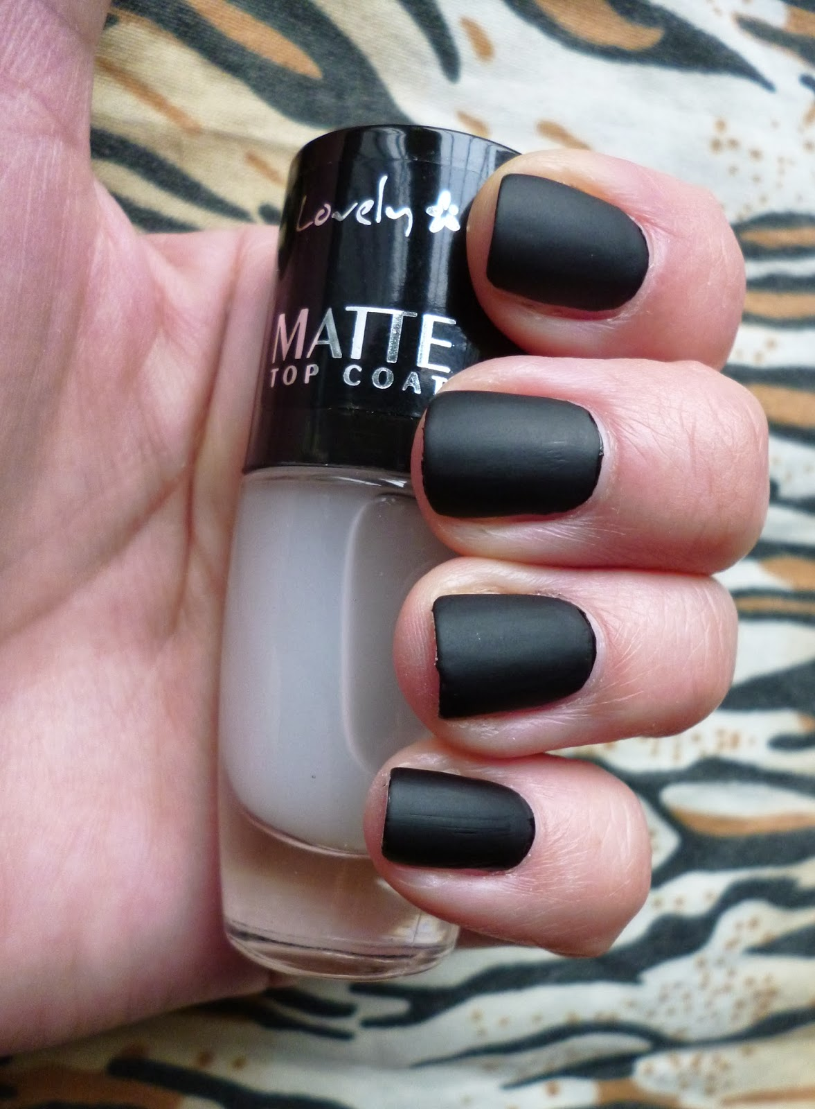 To score the look sans a trip to the salon, run O.P.I.'s Matte Top Coat from the nail base to right before the tips for a luxe contrast.