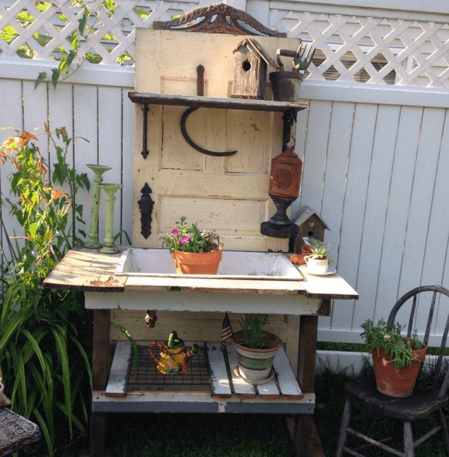 15 Brilliant DIY Ways To Upcycle Your Door - Potting Table
