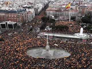 """Demonstrators waving Spanish flags filled the Plaza de Colon in the city centre in the largest protest Sanchez has faced, with their slogan """"For a united Spain, elections now!"""" a reminder of the pressure on his minority government."""