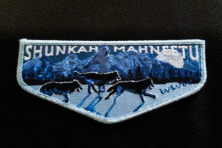 Cramer Imaging's photograph of an Order of the Arrow Shunkah Mahneetu Lodge pocket flap patch with running wolves