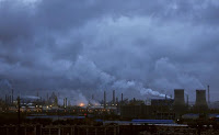 Smoke rises from chimneys and cooling towers of a refinery in Ningbo, Zhejiang province August 19, 2014. (Credit: Reuters/China Daily/File Photo) Click to Enlarge.