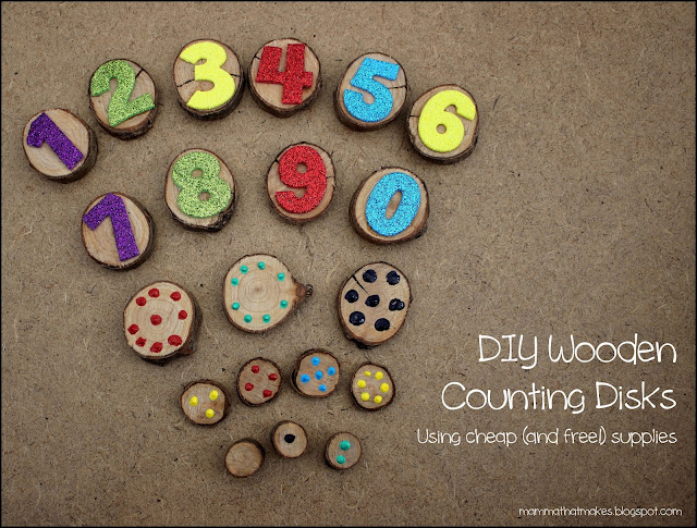 Wooden counting disks made from tree branches, stickers and paint, for busy bags and toddler play.