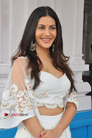 Telugu Actress Amyra Dastur Stills in White Skirt and Blouse at Anandi Indira Production LLP Production no 1 Opening  0053.JPG