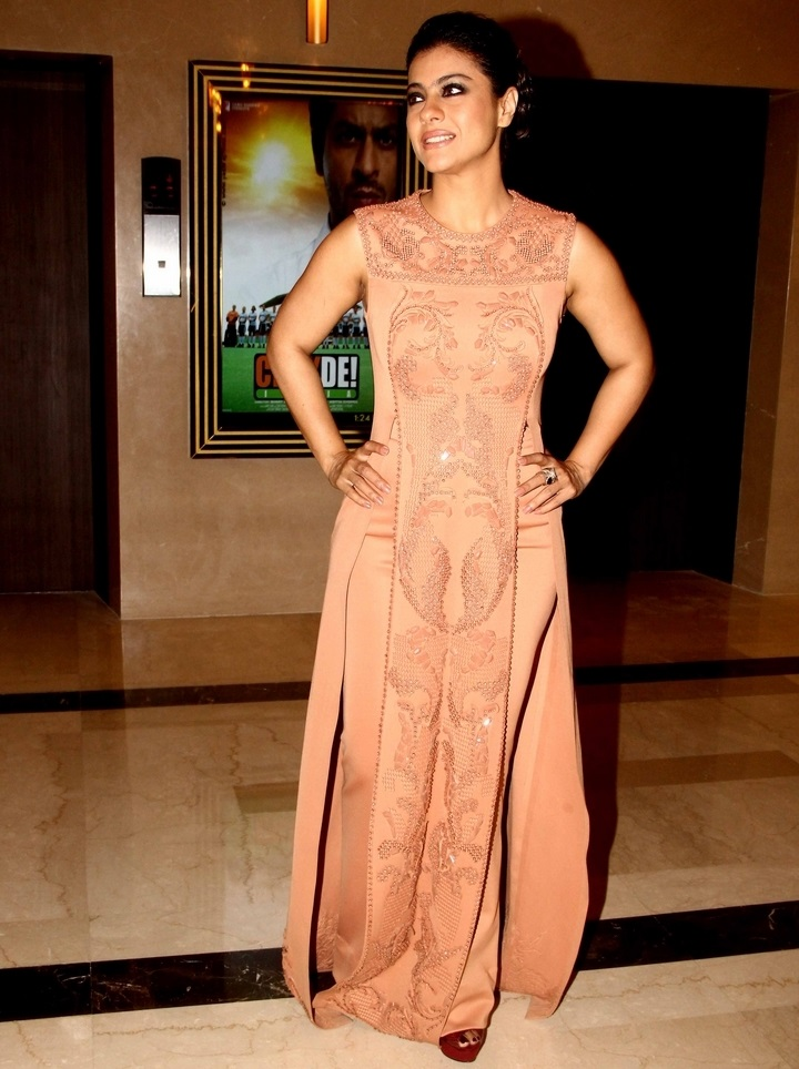 South Indian Women Kajol Hot Smiling Face Photo shoot In Orange Gown