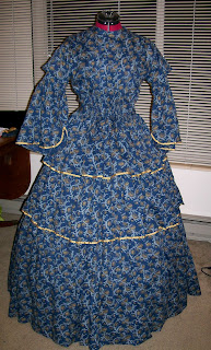 1850s style dress with three tier skirt, open sleeves, shirred bodice.