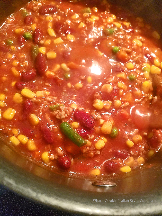 this is a pan of black beans, peppers, chicken and tomatoes for a Mexican filling dinner with flour tortilla this is a Southwest pot of chili with corn and beans