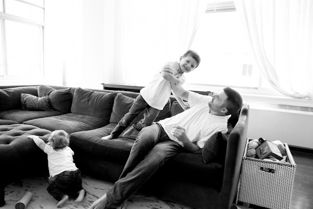 dad and sons playing on the couch