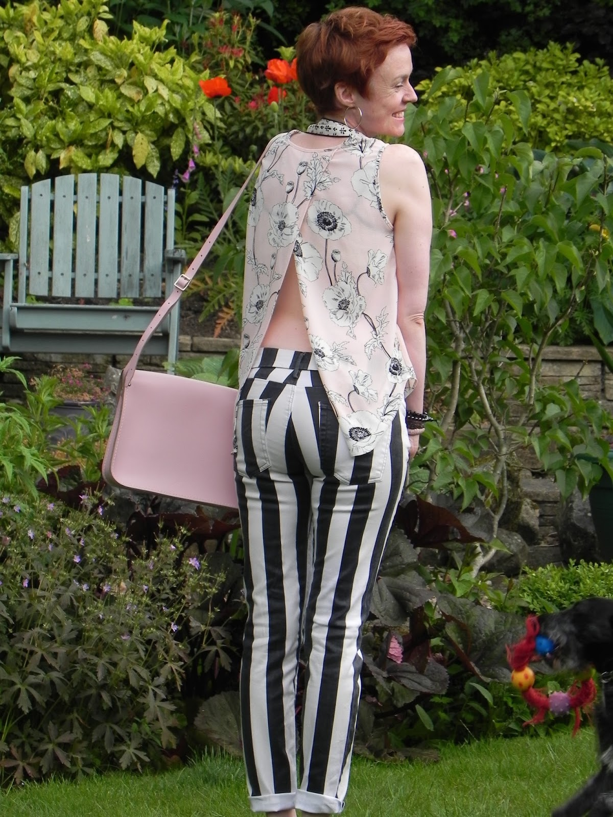 Black and white, striped jeans,pink floral top