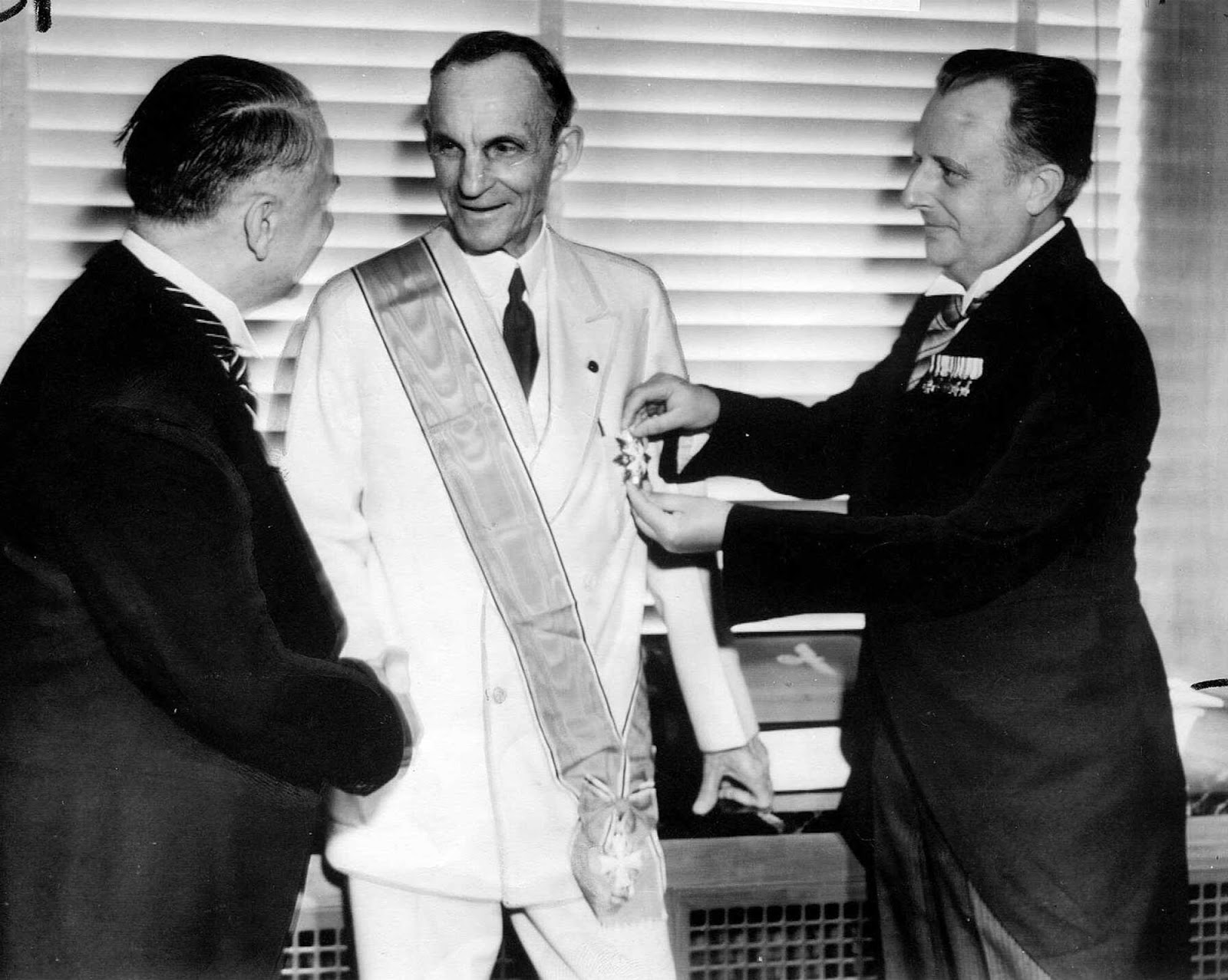 Henry Ford receiving the Grand Cross of the German Eagle from Nazi officials, 1938.
