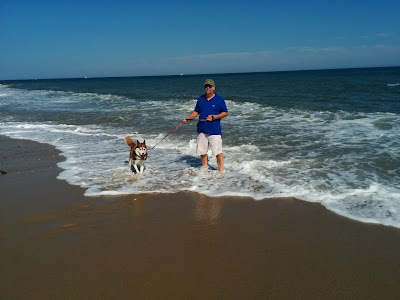 Romping in the surf along the beach of Camp Hero in Montauk, Long Island, NY