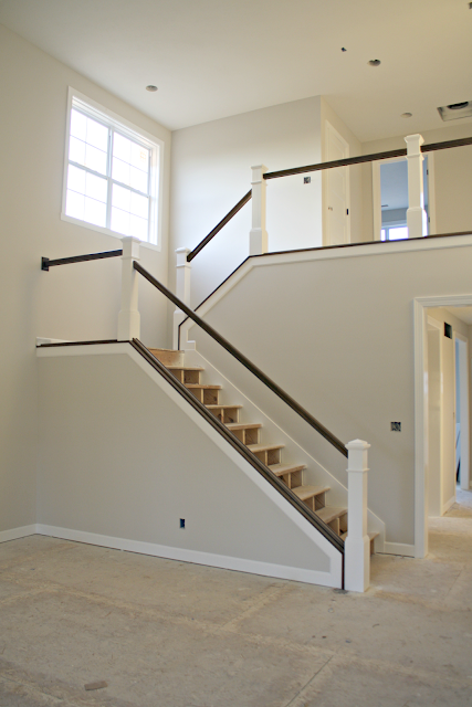 dark stair railings with white balusters