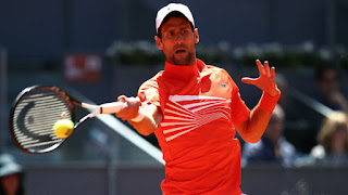 Cilic withdraws, Djokovic reaches Madrid Open semifinals