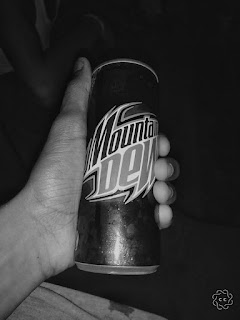 Black and White Mountain Dew Picture with hand Holding it