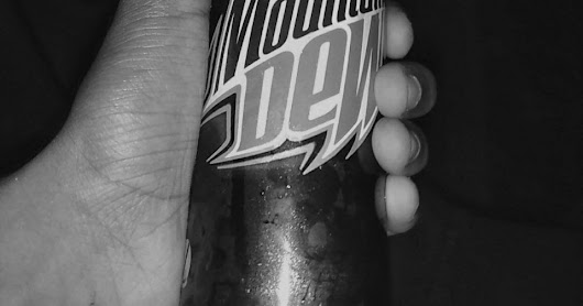 Hand Holding Black & White Mountain Dew Picture