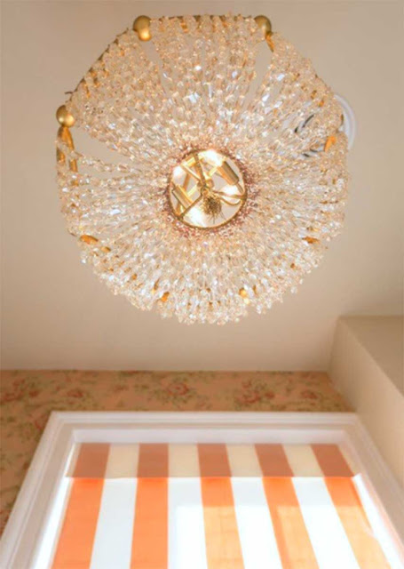 A small bathroom in a classic style design chandelier