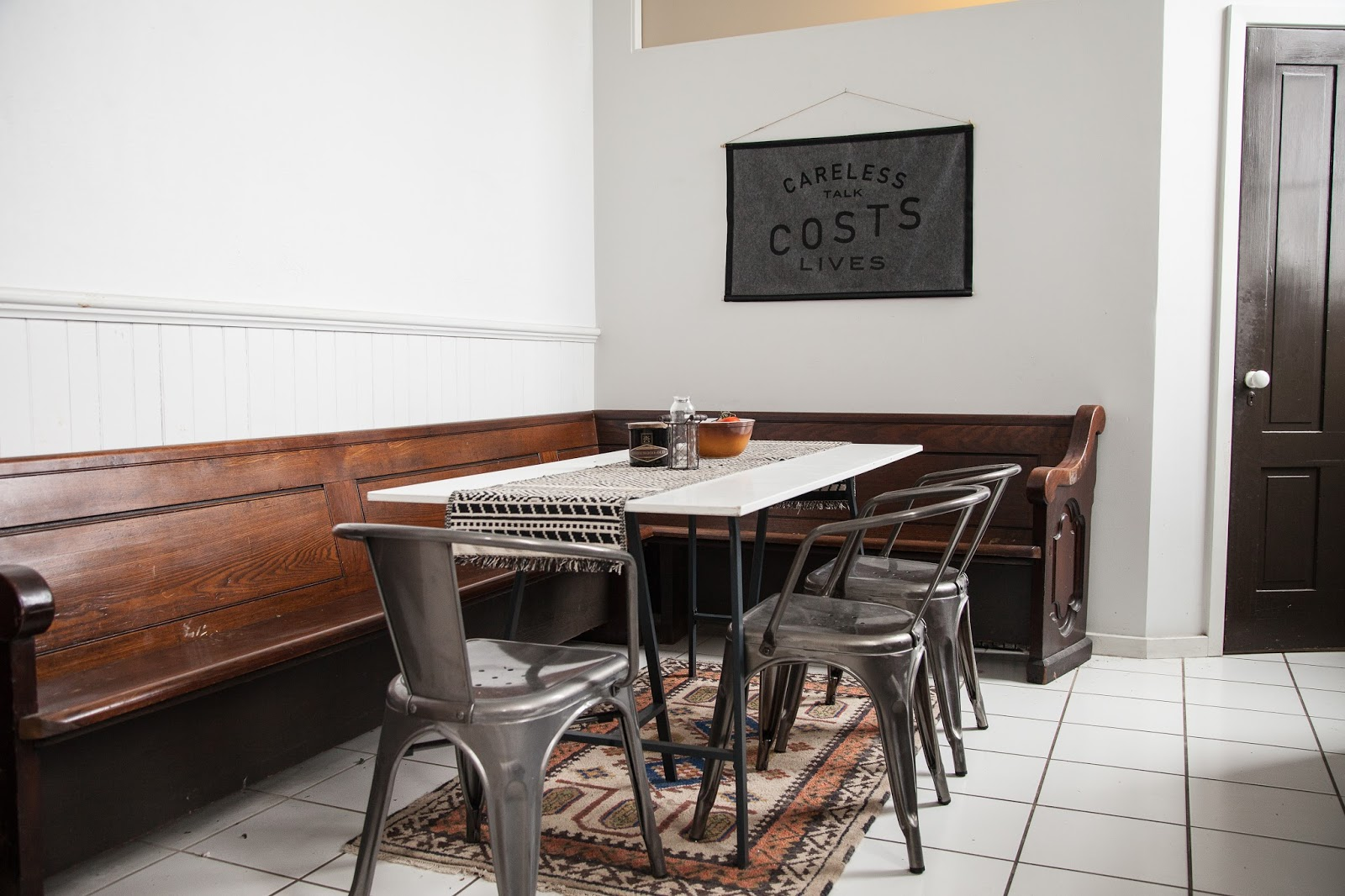 Modern Kitchen with Church Pew and Metal Chairs