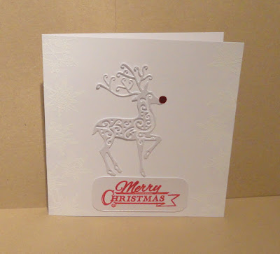 White Christmas card with reindeer with red nose, and red Merry Christmas sentiment