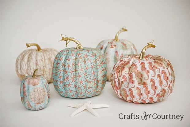 http://www.craftsbycourtney.com/how-to-crafts/mod-podge-fall-coastal-theme-pumpkins/