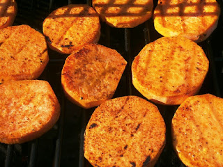 Sweet potatoes cooking on the grill