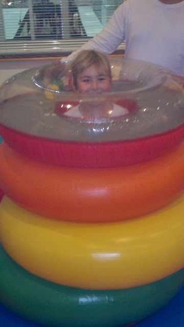 Top Ender in a Giant Inflatable Fisher Price Play Ring set